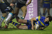 Stefan Ratchford of Warrington Wolves scores his team's second try during the First Utility Super League match between Warrington Wolves and Leeds Rhinos at The Halliwell Jones Stadium on March 13, 2015 in Warrington, England.
