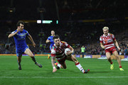 John Bateman of Wigan scores  his sides opening try despite the attention of Stefan Ratchford of Warrington during the First Utility Super League Final between Warrington Wolves and Wigan Warriors at Old Trafford on October 8, 2016 in Manchester, England.