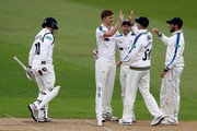 Ben Coad (C) of Yorkshire is congratulated by team mates after taking the wicket of William Porterfield during the Specsavers County Championship One match between Warwickshire and Yorkshire at Edgbaston on April 14, 2017 in Birmingham, England.