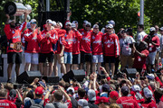Devante Smith-Pelly #25 of the Washington Capitals celebrates with teammates on stage during the Washington Capitals Victory Parade and Rally on June 12, 2018 in Washington, DC.
