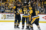 Patric Hornqvist #72 of the Pittsburgh Penguins is congratulated by his teammates after scoring a power play goal during the second period in Game Three of the Eastern Conference Second Round during the 2018 NHL Stanley Cup Playoffs against the Washington Capitals at PPG PAINTS Arena on May 1, 2018 in Pittsburgh, Pennsylvania.
