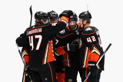Hampus Lindholm #47 and Ryan Kesler #17 congratulate Josh Manson #42 of the Anaheim Ducks after his goal during the first period of a game against the Washington Capitals  at Honda Center on March 6, 2018 in Anaheim, California.