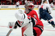 Cam Ward #30 of the Carolina Hurricanes participates in warmups prior to an NHL game against the Washington Capitals on January 2, 2018 at PNC Arena in Raleigh, North Carolina.