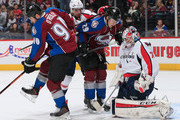 Goalie Braden Holtby #70 of the Washington Capitals makes a save as Nathan MacKinnon #29 and Ryan O'Reilly #90 of the Colorado Avalanche look to control the puck and Matt Niskanen #2 of the Washington Capitals follows the play at Pepsi Center on November 20, 2014 in Denver, Colorado. The Capitals defeated the Avalanche 3-2.