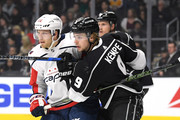 Adrian Kempe #9 of the Los Angeles Kings ties up Lars Eller #20 of the Washington Capitals in front of the net during the first period at Staples Center on March 8, 2018 in Los Angeles, California.