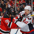 Evgeny Kuznetsov Photos - Jacob Josefson #16 of the New Jersey Devils and Evgeny Kuznetsov #92 of the Washington Capitals battle during the second period at the Prudential Center on December 31, 2016 in Newark, New Jersey. - Washington Capitals v New Jersey Devils