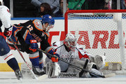Josh Bailey #12 of the New York Islanders misses a shot against Philipp Grubauer #31 of the Washington Capitals in the third period at the Nassau Veterans Memorial Coliseum on March 9, 2013 in Uniondale, New York. The Islanders defeated the Capitals 5-2.