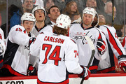 John Carlson #74 of the Washington Capitals celebrates a first period goal with team mates Joey Crabb #15 and Jason Chimera #25 during an NHL game against the Ottawa Senators at Scotiabank Place on January 29, 2013 in Ottawa, Ontario, Canada.