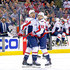 Tom Wilson Photos - Tom Wilson #43 of the Washington Capitals is congratulated by Evgeny Kuznetsov #92 after scoring a goal during the first period of Game Four of the Eastern Conference First Round during the 2018 NHL Stanley Cup Playoffs against the Columbus Blue Jackets on April 19, 2018 at Nationwide Arena in Columbus, Ohio. - Washington Capitals vs. Columbus Blue Jackets - Game Four