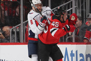 Alex Ovechkin #8 of the Washington Capitals checks Sami Vatanen #45 of the New Jersey Devils during the first period at the Prudential Center on October 11, 2018 in Newark, New Jersey.