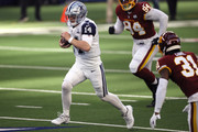 Andy Dalton #14 of the Dallas Cowboys rushes with the ball during the first quarter of a game against the Washington Football Team at AT&T Stadium on November 26, 2020 in Arlington, Texas.