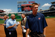 Stephen Strasburg (R), the overall first pick in the 2009 Major League Baseball draft, arrives for a press conference where he was introduced at Nationals Park August 21, 2009 in Washington, DC. Strasburg, a right handed pitcher from San Diego State University, signed with the Nationals earlier this week wth a record contract for an amateur player. Also pictured (L-R) are Nationals Team President Stan Kasten, Nationals GM Mike Rizzo and Strasburg's agent Scott Boras.
