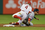 Andres Blanco #4 of the Philadelphia Phillies falls over Ian Desmond #20 of the Washington Nationals on an attempted double play in the eighth inning at Citizens Bank Park on September 16, 2015 in Philadelphia, Pennsylvania. The Nationals won 12-2.