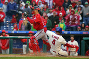 Jose Lobaton #59 of the Washington Nationals forces out Andres Blanco #4 of the Philadelphia Phillies at home plate in the ninth inning during a game at Citizens Bank Park on May 7, 2017 in Philadelphia, Pennsylvania. The Phillies won 6-5 in 10 innings.