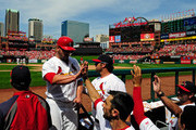 Matt Holliday #7 of the St. Louis Cardinals high fives teammates after scoring during the seventh inning against the Washington Nationals at Busch Stadium on June 15, 2014 in St. Louis, Missouri.