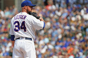 Starting pitcher Jon Lester #34 of the Chicago Cubs looks for the signs before throwing against the Washington Nationals at Wrigley Field on August 11, 2018 in Chicago, Illinois.