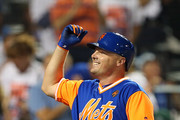 Jay Bruce #19 of the New York Mets reacts after he hit a two-run home run against the Washington Nationals during the eighth inning of a game at Citi Field on August 24, 2018 in the Flushing neighborhood of the Queens borough of New York City. All players across MLB will wear nicknames on their backs as well as colorful, non-traditional uniforms featuring alternate designs inspired by youth-league uniforms. The Mets defeated the Nationals 3-0.