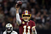 Alex Smith #11 of the Washington Redskins throws the ball during the fist half against the New Orleans Saints at Mercedes-Benz Superdome on October 8, 2018 in New Orleans, Louisiana.