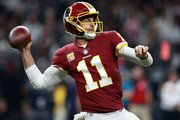 Alex Smith #11 of the Washington Redskins throws the ball during the first half against the New Orleans Saints at the Mercedes-Benz Superdome on October 8, 2018 in New Orleans, Louisiana.