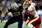 Samaje Perine #32 of the Washington Redskins is tackled by Manti Te'o #51 of the New Orleans Saints during the second half at the Mercedes-Benz Superdome on November 19, 2017 in New Orleans, Louisiana.