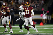 Alex Smith #11 of the Washington Redskins throws the ball during the first half against the New Orlenas Saints at the Mercedes-Benz Superdome on October 8, 2018 in New Orleans, Louisiana.