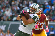Eric Decker #87 of the New York Jets is tackled by Kyshoen Jarrett #30 of the Washington Redskins during the third quarter at MetLife Stadium on October 18, 2015 in East Rutherford, New Jersey.