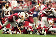 Running back Adrian Peterson #26 of the Washington Redskins is tackled by defensive end Benson Mayowa #91 of the Arizona Cardinals during the third quarter at State Farm Stadium on September 9, 2018 in Glendale, Arizona.