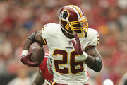 Running back Adrian Peterson #26 of the Washington Redskins rushes the football against the Arizona Cardinals during the NFL game at State Farm Stadium on September 9, 2018 in Glendale, Arizona. The Redskins defeated the Cardinals 24-6.