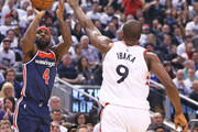 Ty Lawson #4 of the Washington Wizards takes a shot over Serge Ibaka #9 of the Toronto Raptors in Game Two of the Eastern Conference First Round in the 2018 NBA Play-offs at the Air Canada Centre on April 17, 2018 in Toronto, Ontario, Canada. The Raptors defeated the Wizards 130-119. (Photo by Claus Andersen/Getty Images) *** Local Caption *** Ty Lawson; Serge Ibaka