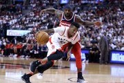 Delon Wright #55 of the Toronto Raptors dribbles the ball as Ty Lawson #4 of the Washington Wizards defends during the second half of Game Five in Round One of the 2018 NBA playoffs at Air Canada Centre on April 25, 2018 in Toronto, Canada.  NOTE TO USER: User expressly acknowledges and agrees that, by downloading and or using this photograph, User is consenting to the terms and conditions of the Getty Images License Agreement.