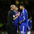 Mike Dean and Diego Costa Photos