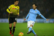 David Silva of Manchester City holds off Almen Abdi of Watford during the Barclays Premier League match between Watford and Manchester City at Vicarage Road on January 2, 2016 in Watford, England.