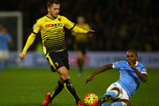 Almen Abdi of Watford is tackled by Fernandinho of Manchester City during the Barclays Premier League match between Watford and Manchester City at Vicarage Road on January 2, 2016 in Watford, England.