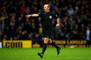 Referee Mike Dean awards a penalty during the Barclays Premier League match between Watford and Norwich City at Vicarage Road on December 5, 2015 in Watford, England.