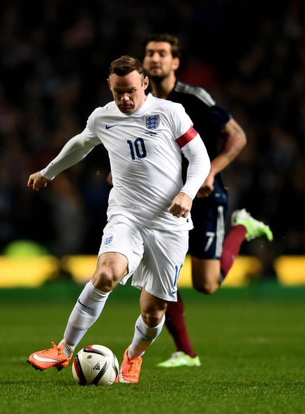 Wayne Rooney X5 Wayne Rooney Wayne Rooney of England is pursued by Charlie Mulgrew of