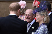 Prince Philip, Duke of Edinburgh talks to Prince Harry, Duke of Sussex and Lady Helen Taylor as they leave after the wedding of Lady Gabriella Windsor to Thomas Kingston at St George's Chapel, Windsor Castle on May 18, 2019 in Windsor, England.