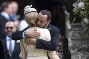 Brother of Pippa, James Middleton embraces girlfriend Donna Air as they arrive for the wedding ceremony of Pippa Middleton to James Matthews at St Mark's Church as the bridesmaids and pageboys walk ahead on May 20, 2017 in Englefield Green, England.