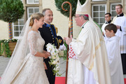 (NO SALES, NO ARCHIVE)  In this handout image provided by the Grand-Ducal Court of Luxembourg, Stephanie de Lannoy and her brother Count Jehan de Lannoy greet Most Reverend Jean-Claude Hollerich, Archbishop of Luxembourg as they arrive to attend the wedding ceremony of Prince Guillaume Of Luxembourg and Stephanie de Lannoy at the Cathedral of our Lady of Luxembourg on October 20, 2012 in Luxembourg, Luxembourg. The 30-year old hereditary Grand Duke of Luxembourg is the last hereditary Prince in Europe to get married, marrying his 28-year old Belgian Countess bride in a lavish 2-day ceremony.