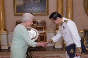 Queen Elizabeth II receives His Excellency, Mr Meas Kim Heng who presented his Letters of Credence as Ambassador from the Kingdom of Cambodia to the Court of St James's  at Buckingham Palace, on October 15, 2014 in London, England.