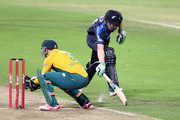 (SOUTH AFRICA OUT)   Morne van Wyk of South Africa almost runs out Grant Elliott (R) of New Zealand during the 1st KFC T20 International match between South Africa and New Zealand at Sahara Stadium Kingsmead on August 14, 2015 in Durban, South Africa.