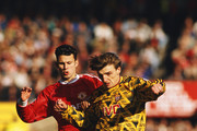 Manchester United player Ryan Giggs (l) challenges Arsenal player Tony Adams during a Division One match between Manchester United and Arsenal at Old Trafford on October 19, 1991 in Manchester, England.