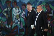 German Interior Minister Horst Seehofer (L) and Economy and Energy Minister Peter Altmaier arrive for the weekly government cabinet meeting on October 24, 2018 in Berlin, Germany. High on the morning's agenda was a review of Germany's export policy for conventional weapons for the first half of 2018.