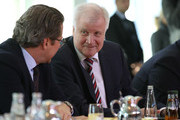 German Interior Minister Horst Seehofer (C) arrives for the weekly government cabinet meeting on October 24, 2018 in Berlin, Germany. High on the morning's agenda was a review of Germany's export policy for conventional weapons for the first half of 2018.