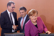 German Chancellor Angela Merkel (CDU, R), Vice Chancellor and Foreign Minister Sigmar Gabriel (SPD, C) and Development Minister Gerd Mueller (CSU) arrive for the weekly German federal Cabinet meeting on March 7, 2018 in Berlin, Germany. High on the meeting's agenda was discussion of the country's military presence abroad.