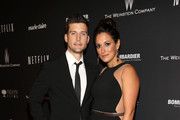 Actors Parker Young (L) and Angelique Cabral attend The Weinstein Company & Netflix's 2014 Golden Globes After Party presented by Bombardier, FIJI Water, Lexus, Laura Mercier, Marie Claire and Yucaipa Films at The Beverly Hilton Hotel on January 12, 2014 in Beverly Hills, California.