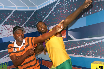 Wellesley Bolt Usain Bolts Parents Pose With Waxwork Figure At Madame Tussauds