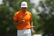 Rickie Fowler inspects his golf ball following his par putt on the second green during the final round of the 2018 Wells Fargo Championship at Quail Hollow Club on May 6, 2018 in Charlotte, North Carolina.