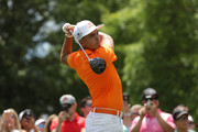Rickie Fowler plays his tee shot on the third hole during the final round of the 2018 Wells Fargo Championship at Quail Hollow Club on May 6, 2018 in Charlotte, North Carolina.