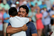 Jason Day and Dash Day Photos Photo