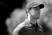 This image has been converted to black and white) Rory McIlroy of Northern Ireland walks off the third tee during the first round of the 2018 Wells Fargo Championship at Quail Hollow Club on May 3, 2018 in Charlotte, North Carolina.